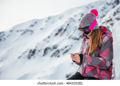 Girl texting outdoors on the mountain peek.