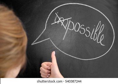 Girl thinking in front of chalk board