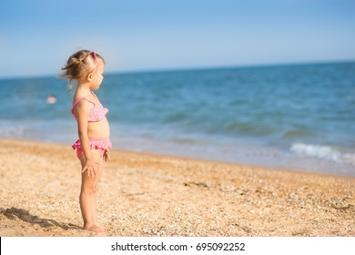 A girl three years old on the beach