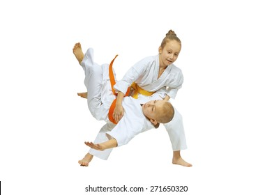 Girl throws the boy through the thigh on the mat