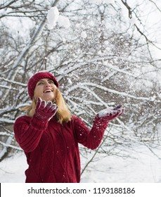 Girl throws snow, red sweater, winter holidays