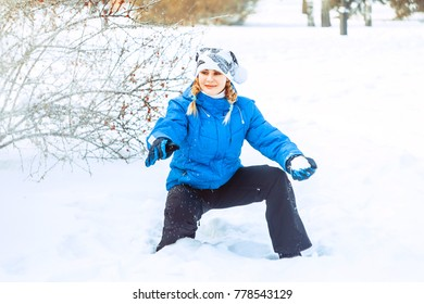 the girl throws the snowball