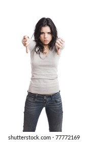 Girl with thumbs down, isolated against a white background
