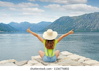 girl with thumbs up on summer vacation Kotor bay Montenegro