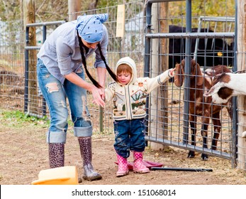 Girl toddler with her mom on the farm.