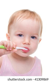 Girl with toothbrush  isolated on a white background.