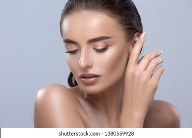 girl touching ear, beautiful woman looking down, pretty female model