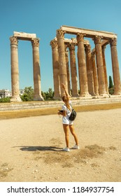 girl tourist in the ancient Greek temple of Zeus