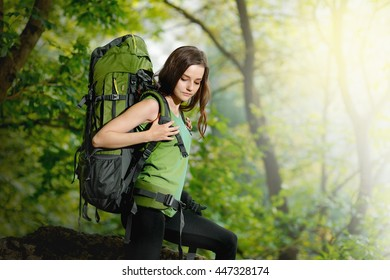 Girl tourist with a backpack going to the mountain