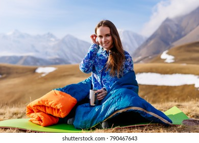 girl tourist meets the morning for a mug of tea in the Caucasus Mountains