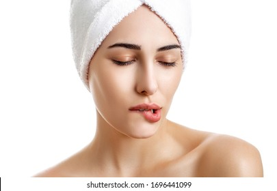 Girl with towel on head on white background,with clear skin.