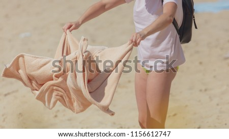 8b5ab63ff ... Stock Photo (Edit Now) 1156612747 - Shutterstock. Girl with a towel on  the sand on the beach