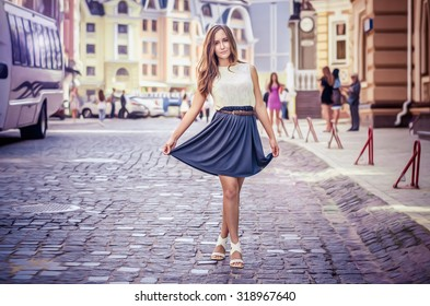 girl in town, a beautiful girl on a background of colorful buildings
