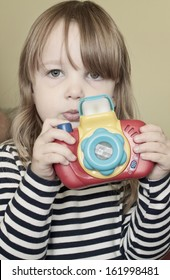 Girl with toy camera