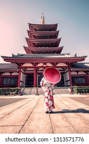 Girl with traditional dress in Senso-ji temple in Asakusa, Tokyo