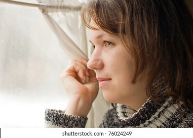 Girl in train looks out of window