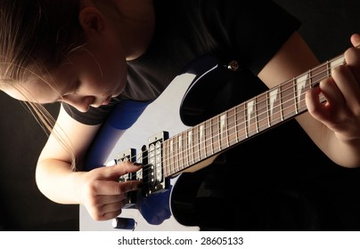 The girl is trained to play a guitar
