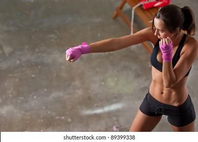Girl training body combat