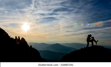 girl training her dog on top of the mountain
