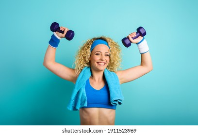 Girl trains with handlebars. cyan color background