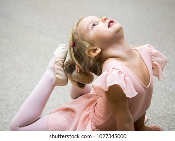Girl trains stretching exercises for Ballet in class