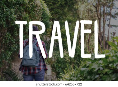 Girl traveler with backpack in a forest from the back