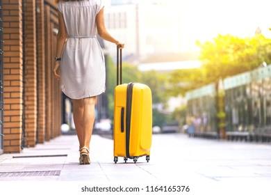 girl traveler and her yellow  luggage. wonderful travel
