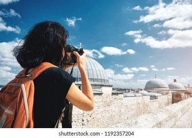 Girl traveler photographer taking pictures of landscapes of istanbul