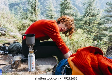 Girl traveler in red, woolen sweater, on the way in the Himalaya mountains, Nepal.