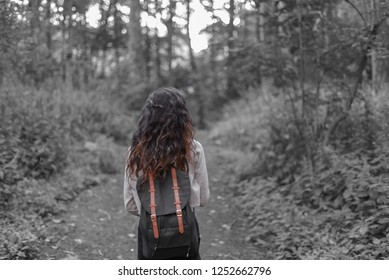 Girl traveling alone through the forest.
