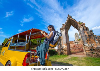 Girl traveling in Ayutthaya province with tuk tuk taxi