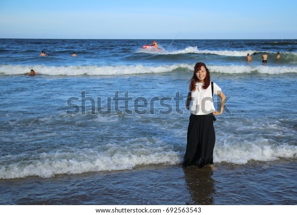 A girl travels to Samson beach in Vietnam