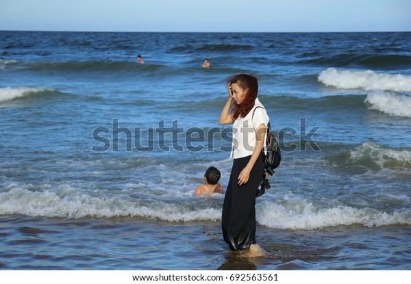 A girl travels to Samson beach in Vietnam