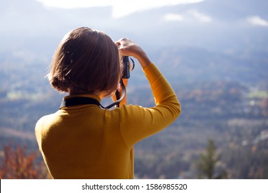 girl travels and takes pictures on camera.