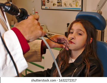 Girl is treated by doctor otolaryngology for medical review