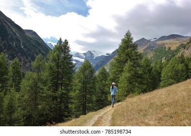 Girl trekking in Gran Paradiso National Park. Valnontey, Aosta Valley. Italy