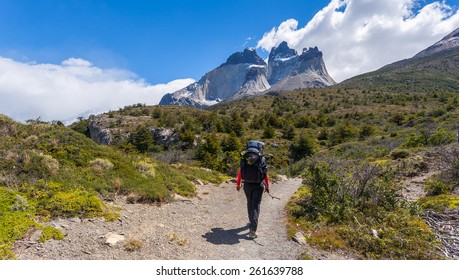 Girl trekking to see Horns of Paine in Torres Del Paine National Park, Chile