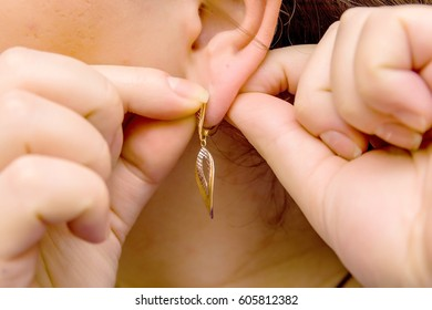 Girl tries on the earring