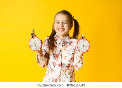 the girl with tropical fruit on a yellow background
