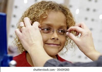 girl trying on eye glasses