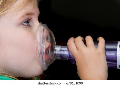 Girl trying to treat her asthma with an inhailer