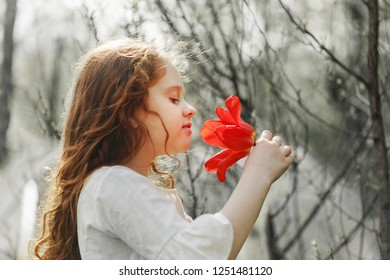 Girl with tulip flower, photo in the profile. Healthy breathing.