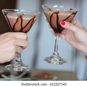Girl with two chocolate cocktails