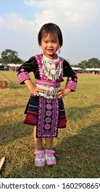 A girl and two Hmong hill tribe costumes in the Hmong New Year's party On 28/12/2019 at Khirirat Subdistrict, Phop Phra District, Tak Province, Thailand Two Hmong hill tribe women at the Hmong new yea