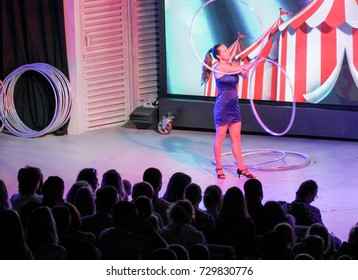 A girl with two hoops. Yalta, Crimea - 11 July, 2017. Performance of young artists on the stage of the hotel Yalta Intourist ..