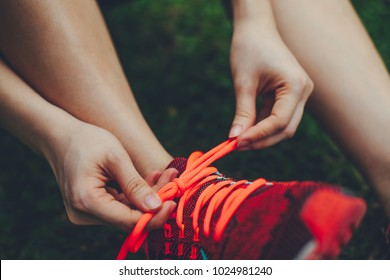 Girl tying her shoe lace