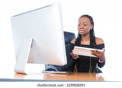 The girl is typing on the computer. African business woman. Blacks fashion model. The girl is engaged in affairs at the computer. Business acumen. A woman from Africa.