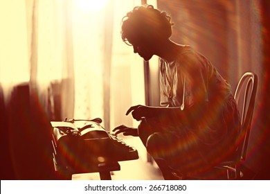 girl typing on a typewriter