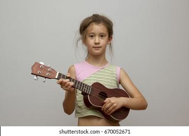 girl with ukulele guitar