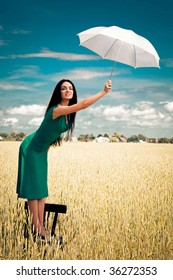 girl with an umbrella in the field